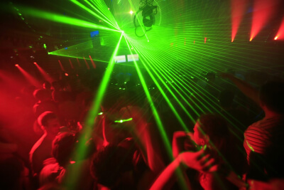 night club music event party with laser lights background